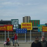 people walking in front of colorful signs