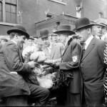 Municipal inspectors examining produce at the market