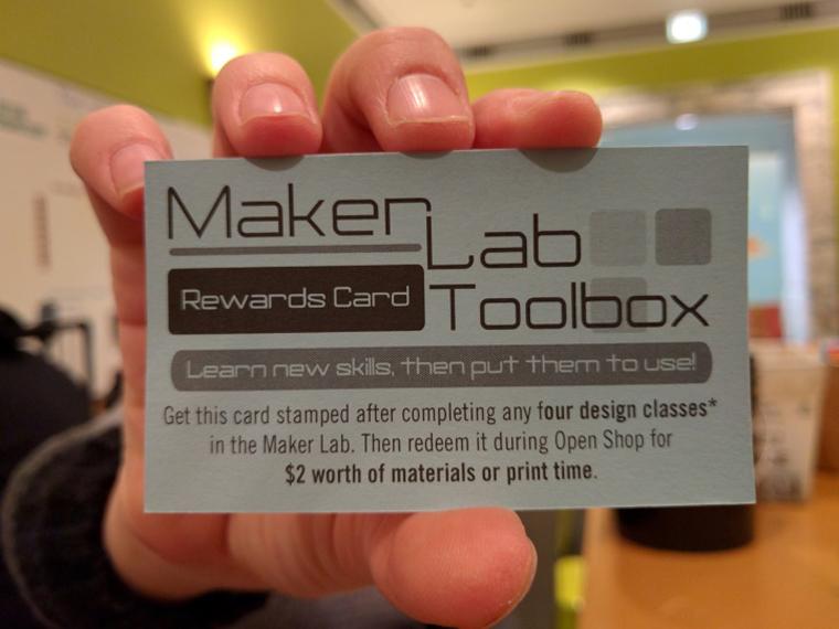 Hand holding a Maker Lab Rewards Card
