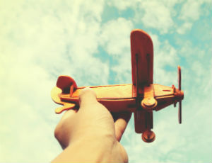 Person flying toy plane