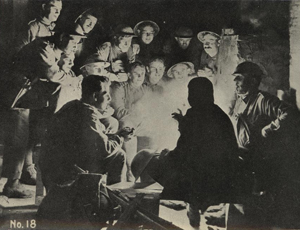 black and white illustration of people telling stories around a campfire