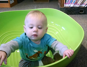 child uses a rocking bowl at a CPL location