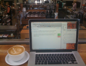 Working on a laptop in a coffee shop