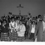 Mayor Harold Washington attends a St. Patrick's Day rally at Holy Angels School, where exchange teachers from Ireland spent the 1986-1987 school year. Source: Harold Washington Archives and Collections: Press Office Photographs, Box 60, Folder 5. Photographer: Antonio Dickey
