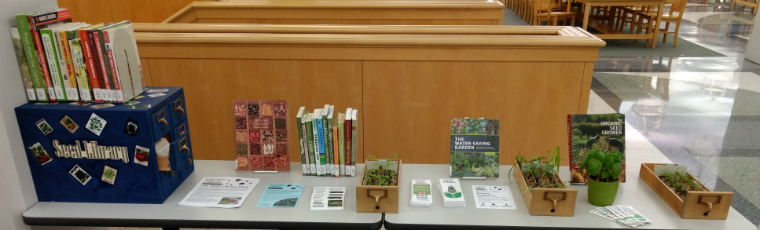 Seed Library and books on display with flyers