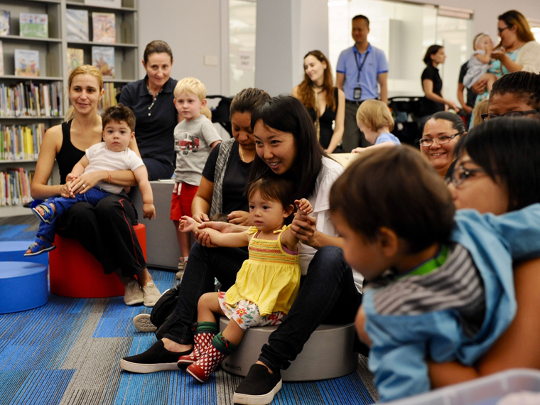 Babies, toddlers and caregivers gather for story time at Thomas Hughes Children's Library