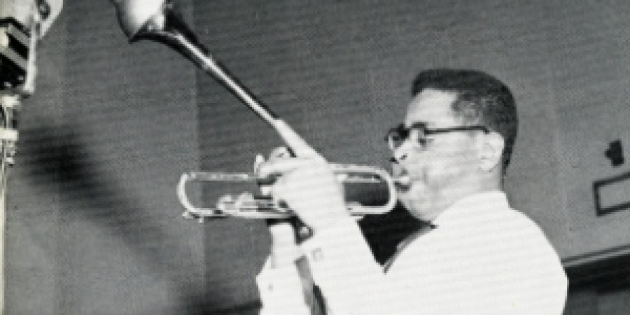 Dizzy Gillespie plays his trumpet.