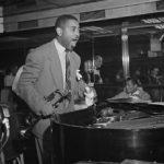 Dizzy Gillespie holding his trumpet