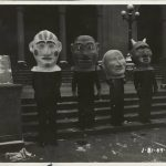 Four people wear grotesque heads. Source: Special Collections, Chicago Park District Records: Photographs, Image 043_005_006