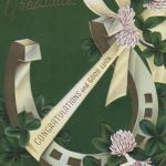 horseshoe decorated with ribbon and clover