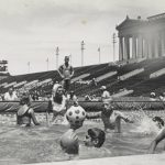 Athletes play water polo in the specially constructed swimming pool at Soldier Field for the Special Olympics, undated. [Anne Burke] looks on. Source: Chicago Park District Records: Photographs, Special Collections, Image 125_005_013.