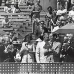 Eunice Kennedy Shriver speaks at the opening of first Special Olympics, 1968. Illinois Governor Sam Shapiro is at left. Source: Chicago Park District Records: Photographs, Special Collections, Image 125_001_006.