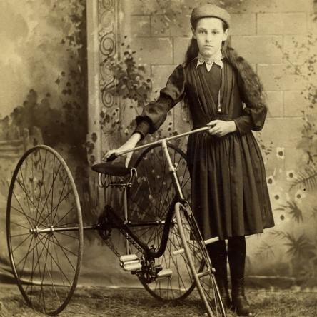 Girl with tricycle
