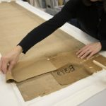 Nichols carefully removes the old, damaged lining. Photographer: Johanna Russ