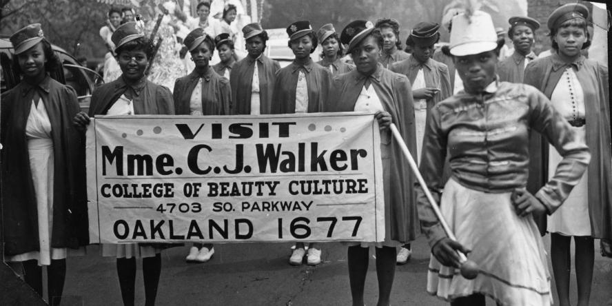 Mme. C.J. Walker College of Beauty Culture marching corps in Bud Billiken parade, 1950s.