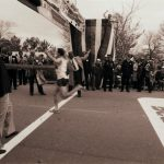 Mayor Washington holds the finish line for the male winner, Steve Jones, during the 1985 Chicago Marathon, 1985 October 20. Photographer: Antonio Dickey.