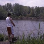 Man Fishing at Indian Ridge Marsh, 2000. Source: Open Space Section Records, Photographs Series, Box 6, Binder 5, Special Collections, Chicago Public Library
