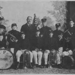 group of band members holding instruments