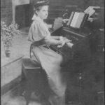 woman in dress at organ