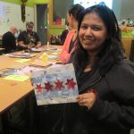 Made in the Maker Lab: A patron holds a collage of the Chicago flag.