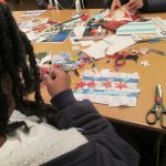 Made in the Maker Lab: A patron creating a collage of the Chicago flag.