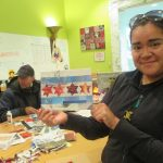 Made in the Maker Lab: Library patron holding a collage of the Chicago flag.