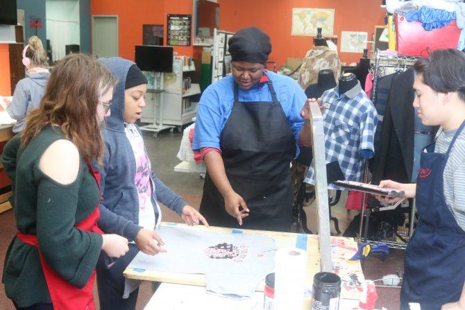 Teens use screen printing equipment to make a T-shirt