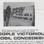 """Ramona Rickett stands next to Mobil Oil Victory Sign at the South East corner of Madison and Central; People Victorious! Mobil Concedes!!! On July 10th Judge Healy denied Mobil Oil's request for a """"variance"""" so they could put up a gas station at Madison and [text ends]"""