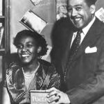 Man and woman posing with book