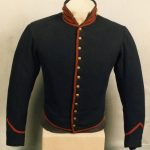 Blue jacket with red trim and gold buttons