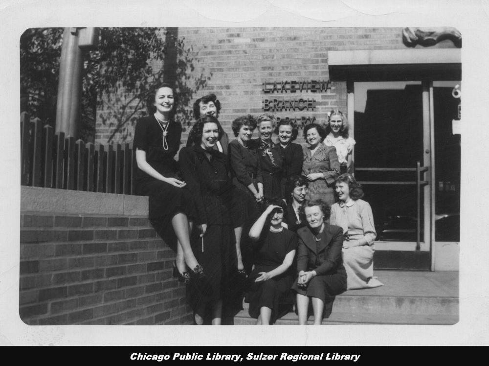 Women posing in front of library