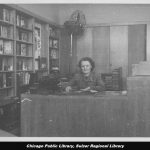 Woman sitting at desk in library