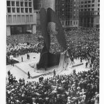 Picasso statue surrounded by crowds