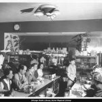 Staff and customers at diner counter