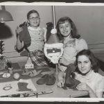 three girls showcase holiday crafts