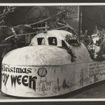 float featuring Santa and reindeer reads Christmas Toy Week