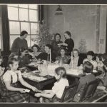 group of women and girls gathering around a dining table