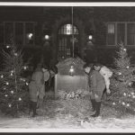 boys scouts look at a nativity scene