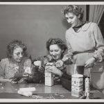 three women create crafts from milk cartons