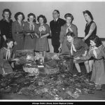 Girl Scouts and adults with piles of tin cans