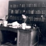 Vivian G. Harsh seated at her desk with the Special Negro Collection pictured behind her, early 1930s. Source: George Cleveland Hall Branch Archives, photo 019