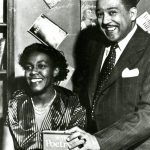 Man and woman posing with book, The Poetry of the Negro