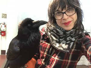 Jess posing with a raven
