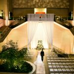 Bride and Groom in Deferrari Hall with seating on the right of the couple