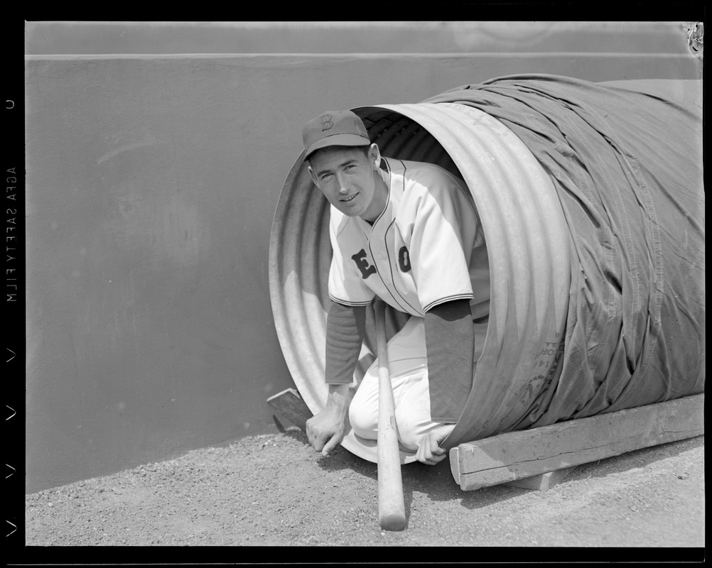 Ted Williams posing in canvas cover at Fenway Park