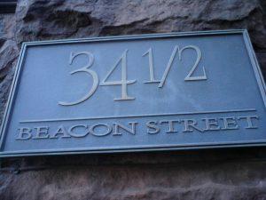 An address plaque for 34 1/2 Beacon Street