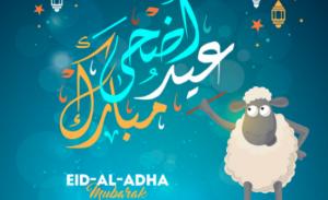 A lamb writing Eid-Al-Adha Mubarak in Arabic and English