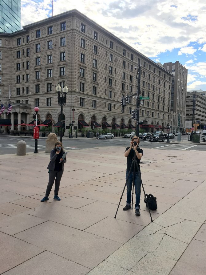 Members of BPL's Audio/Visual team film the McKim highlights tour on the Dartmouth plaza.