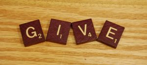 Give spelled out with Scrabble tiles
