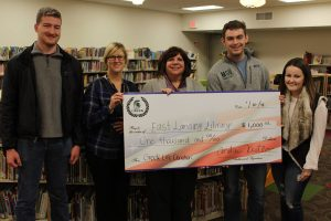 MSU Greek Life students donating one thousand dollars to ELPL